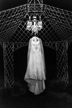 Unique shot of a wedding dress in the dark at the Barn at Chestnut Springs in Sevierville.  Since this was a sunrise wedding ceremony, the bride got dressed reallllly early.