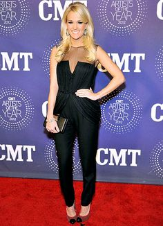 Carrie Underwood traded in her country style for a hipper look in a black Katharine Kidd onesie for the 2012 CMT Artists of the Year show on Dec. 3, 2012.