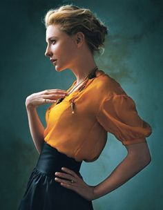 This orange blouse is so elegant.