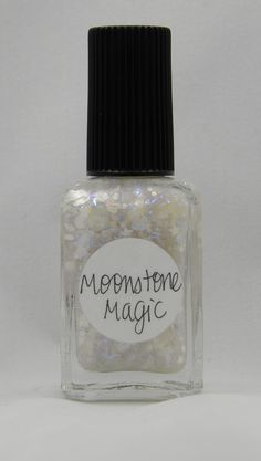 Moonstone Magic (June) is full of white moons and stars, assorted white shapes, various blue iridescents, tiny holographic silver stars and rainbow dust in an intense blue-shimmered clear base.