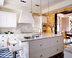 Glamorous Spanish home filled with bold accents and graphic tile floors. Designed by Soledad Suárez de Lezo--image via Mix and Chic #kitchen