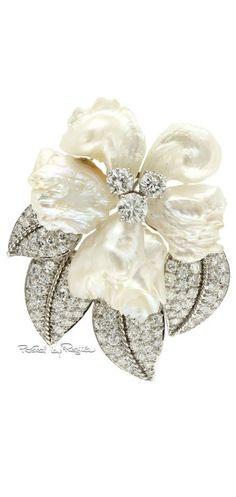 Regilla William Ruser - Brooch. Diamonds, Mississippi Fresh Water Pearl, and Platinum. Circa 1940's.