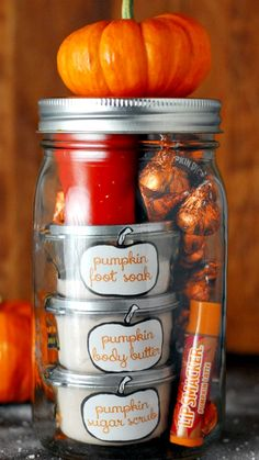 DIY Pumpkin Pamering Jar ~ a large mason jar filled with delicious scented pumpkin body care products, pumpkin treats and a pumpkin candle.
