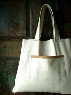 up cycled white leather bag from etsy .
