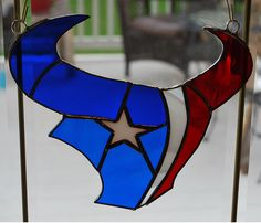 This Stained glass Houston Texans sun catcher, wall hanging is finished in a Tiffany style copper foil technique and is approx. Ron Glass, Glass Art, Stained Glass Projects, Stained Glass Patterns, Bulls On Parade, Texans Logo, Houston Texans Football, Mosaic Glass, Beveled Glass