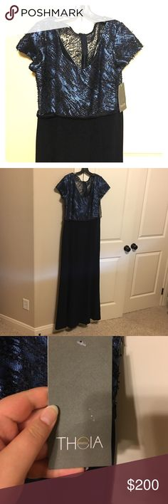 Theia Couture Long Gown Size 14 Gorgeous navy Theia Couture size 14 gown. It has beading on the bodice and cap sleeves. It has a slit on the left side that is knee high. It is brand new and has never been worn! Theia Dresses Prom