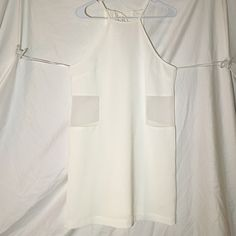 White Mesh Cut Out Dress White fres with back tie closure. Panels on sides are mesh and see through! Size small. Length of the dress is 30.5 inches. Dresses