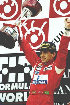 McLaren Ford driver Ayrton Senna of Brazil holds the trophy aloft after his victory in the Japanese Grand Prix at the Suzuka circuit in Japan. Parkour, Formula 1, Aryton Senna, San Marino Grand Prix, Japanese Grand Prix, Mclaren F1, F1 Drivers, F1 Racing, Drag Racing