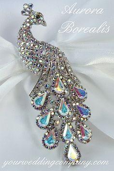 Aurora borealis peacock pin via www.yourweddingcompany.com