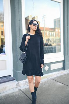 pleated black dress