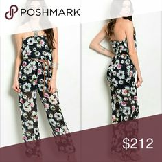 Floral Strapless jumpsuit Lovely floral print jumpsuit navy blue with multi color floral print.   Partial lining-Belt included-strapless-slip on style 100%polyester   XX New no tags XX Price is firm XX Pants Jumpsuits & Rompers