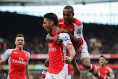 Walcott, who had several chances to open the first half scoring himself, leaps on Giroud's...