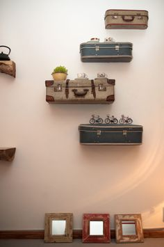 Suitcases as shelves--for my travel themed room?!