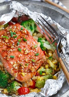 Sriracha honey salmon vegetable packets are an all-in-one meal that couldn't be easier to prepare!