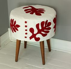 I have the perfect ottoman for the nursery. It just needs to be covered!