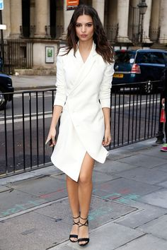 Emily Ratajkowski absolutely nails menswear inspired evening wear in this white coatdress. Added bonus: that asymmetrical hem. (Photo: Neil Mockford/Alex Huckle/GC Images)