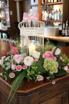 a candle lit Bird Cage surrounded by a sumptuous array of luscious blooms including some fabulous Liliputt Asters
