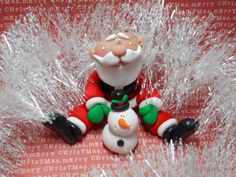 Polymer Clay Sitting Santa with His Snowman by ClayBabiesInc