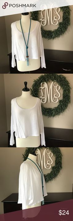 We the Free - Free People White Crop Top Small Free People - We the Free long sleeve see through white crop top. Made of a linen and rayon blend. A cool cheesecloth material with natural knots. Perfect with black anoname jeans I'm selling! Free People Tops Crop Tops