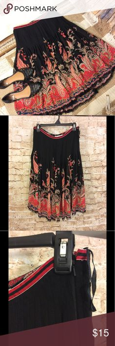 Worth boHo Paisley print fit and flair skirt sz6 Very nice worth fit and flare BoHo style skirt Paisley print Side zipper Frayed hem line Fully lined Pleated  Silk/wool blend Link from top to bottom approximately 27 inches Waste is approximately 13 1/2 inches Hip is 19 inches Black with red paisley print Worth Skirts A-Line or Full