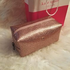 """✨Kate Spade ♠️Rose Gold Makeup Bag Stunning Large Cosmetic Case/ Makeup Bag by Kate Spade. Features a small pocket inside. New- never used. Rose gold Kate Spade logo on outside. Approx 7.5"""" length, 4"""" width, 4"""" height. Tag inside bag as purchased. Could store a handful of products in here. kate spade Bags Cosmetic Bags & Cases"""
