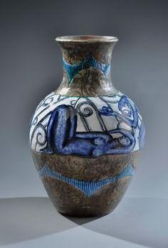 Edouard Cazaux— Reclining nude figure earthenware vase,baluster shape with a frieze of blue figures. Circa-1930