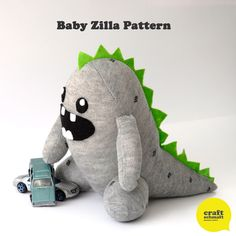 Baby Zilla Pattern (PDF)  Just a single sock, some felt and stuffing and you're on your way to a plush baby Zilla.