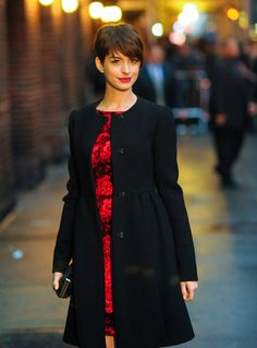 Anne Hathaway, well love her, but this is a very flattering cut of coat. I've tried a few on like this and if cut properly does NOT add bulk, nice pop of color!