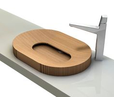 This attractive wood vessel sink show off the beauty of wood in an unexpected setting. Wood is rarely perceived as a… Wooden Bathroom, Bathroom Basin, Bathroom Furniture, Cool Furniture, Modern Furniture, Furniture Design, Niche Design, Wood Sink, Home Tools