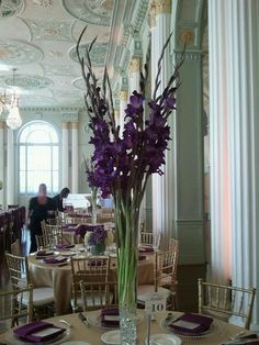 This vertical centerpiece was put together with stems of gladiolus and tall branches (willow, maybe) in a narrow glass vase. Masquerade Centerpieces, Gold Wedding Decorations, Balloon Centerpieces, Flower Decorations, Wedding Centerpieces, Quinceanera Centerpieces, Wedding Ideas, Wedding Goals, Centerpiece Ideas