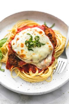Learn how to make this easy healthy baked chicken parmesan for a simple and delicious meal that will be on your table in just 30 minutes.