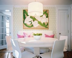 breakfast nook design with green trellis Manauel Canovas Wallpaper, Jonathan Adler brass Meurice pendant chandelier, white slipcpvered bench, round white pedestal dining table, white plastic modern dining chairs, green botanical art and pink pillows. Eileen Kathryn Boyd. Patrick Cline Photography. Lonny Mag