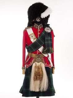 British (Scottish) Uniform of a Lieutenant of the Gordon Highlanders ~ first quarter of the 20th century ~ Doublet of red wool with buff collar and cuffs, piped white, with gold bullion braid and regimental collar insignia, and with gold cord shoulder boards with rank insignia. Wool kilt is in regimental tartan -Watch Free Latest Movies Online on Moive365.to