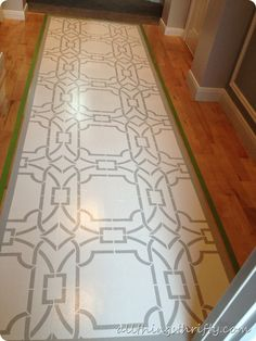 How to paint a floor {and what NOT to do}.  Personally I would paint a runner rug, not the hardwood floor.  But I love the design.