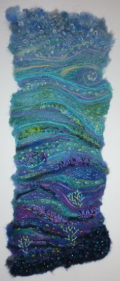 AWESOME!...but really?! a baby-wipe?!  seascape    Made by embellishing merino tops, silk bricks, ribbons and yarns onto a baby-wipe, then adding detail with hand embroidery and beads.  More detail about how I made it is here su-livingontheedge.blogspot.com/2011/01/busy-doing-lots-o...