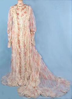 Circa 1900 FERNANDE BUREL, PARIS Floral Silk Chiffon Victorian Fancy Trained Dressing Gown. Pink roses silk chiffon, extra fancy design, gathered into fleur-de-lis / four-leaf clover lace inserts, empire waist, trained back, silk ribbons. Comes attached to the original underslip of off-white tissue china silk, button front. Complete with the Parisian label.