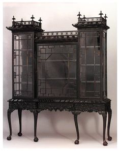Recherche Documentaire - This absolutely magnificent antique Chippendale inspired glass cabinet with finials, fretwork, and hand carved panels, sits atop slender cabriole legs and Ball & Claw feet. It is so graceful and gorgeous, so traditional and elegant that I just want to fill it with 18th century Neo-classical dollhouse furniture from The Ferd Sobol Editions. Just imagine! If you have never seen his work - take a peek: www.SobolEditions.com