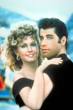 Because of Grease & John Travolta...my dream guy is dark hair blue eyes light skinned BIG lips & butt :)