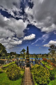 The palace of Tirta Gangga on the east coast of Bali is a must see in the middle of the amazing rice terraces of Bali. On the biggest size you can see Lombok on the horizon. Beautiful Places In The World, Beautiful Places To Visit, Places Around The World, Around The Worlds, Bali Lombok, Komodo Island, Gili Island, Bora Bora, Bali Tour Packages