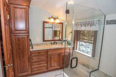 Master Bathroom, Grand Island NY. Haas Monticello Cherry Cinnamon Cabinets, Brazilian White Countertop
