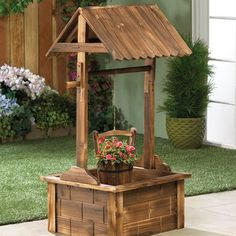 Wishing Well Garden Planter is part of Wishing well garden - A stunning showcase your favorite summer blooms! This absolutely charming outdoor planter features fir wood construction, a squared wishing well pavil Wood Planters, Outdoor Planters, Garden Planters, Outdoor Decor, Outdoor Living, Vertical Pallet Garden, Pallets Garden, Wood Pallets, Diy Pallet Projects