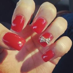 Got my nails done! Acrylic gel nails Red with a diamond bow on the ring finger