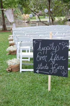 Backyard wedding signage and babies breath buckets <3