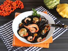Italian Food Forever » Squid Ink Pasta With Shrimp and Scallops - Happy Halloween! Black squid ink pasta is paired with shrimp and scallops in a light white wine sauce in this Halloween-inspired pasta dish.