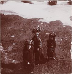 Marie, Olga, Anastasia from above, on a decorative lawn in winter