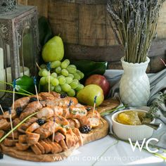 Charcuterie display with fresh herbs by Heirloom Cuisine, LLC. Picture by Warren Conerly Photography.