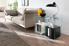 Magique End Table made in Italy by Fiam and designed by Studio Klass, Magique Side Table is made entirely of glass with an inner welded glass cube for storage and display. Magique End Table offers flexibility of placement and exceptional functionality. Modern Side Table, Modern Coffee Tables, Glass Furniture, Furniture Design, Modern Furniture, Design Transparent, Glass End Tables, Side Tables, Italian Furniture