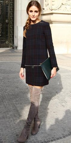 Palermo stepped out in plaid, pairing a long-sleeve shift with taupe suede Stuart Weitzman thigh-high boots and an oversized forest-green clutch.