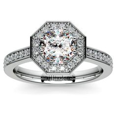Stunning sparkle: Thirty six sparkling round-cut diamonds are prong set in this Halo Diamond Engagement Ring setting in Platinum, accenting the center diamond with glamorous beauty like no other... Pop the question with this spectacular surprise, and leave her speechless!