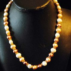 Beautiful_pastel_colored_freshwater_pearls_with_goldtone_knots_in_between_and_a_magnetic_clasp_1